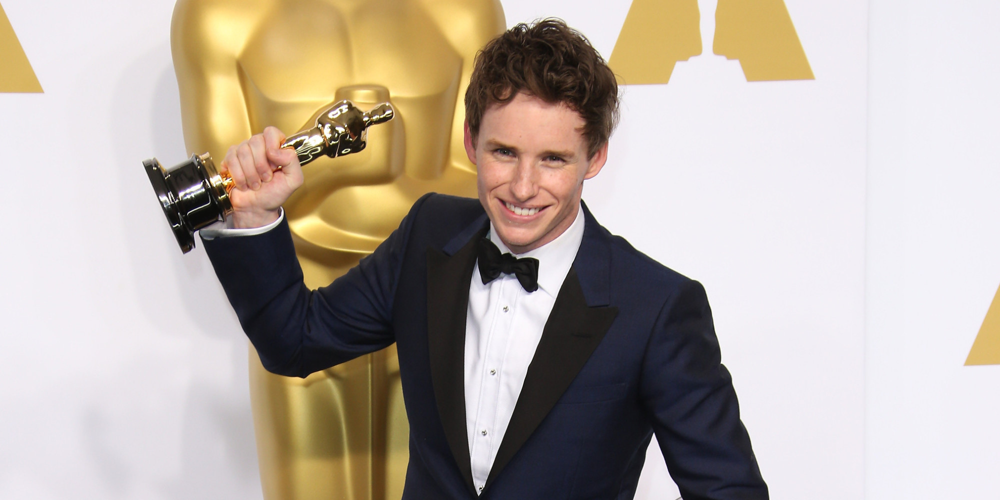 HOLLYWOOD, CA - FEBRUARY 22: Eddie Redmayne poses in the press room with his award for Best Actor at the 87th Annual Academy Awards at Hollywood & Highland Center on February 22, 2015 in Los Angeles, California. (Photo by Dan MacMedan/WireImage)