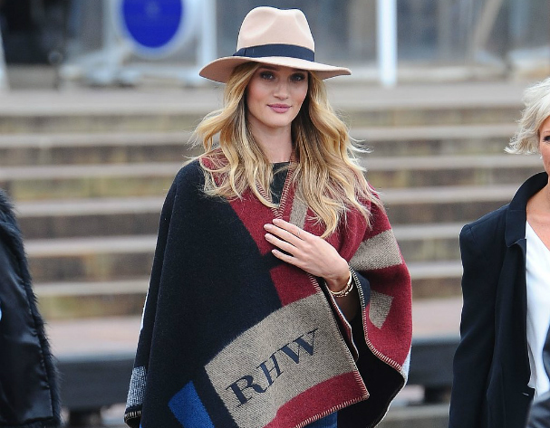 Pondering a poncho - Rosie Huntington-Whiteley