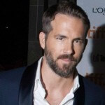 Ryan Reynolds suited and booted