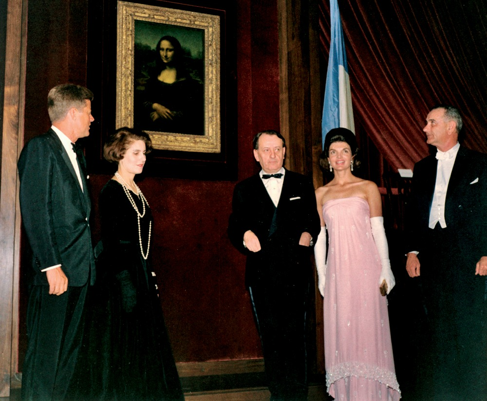 "KN-C25928 President Kennedy, Mrs. Kennedy, Vice President Johnson, Andre Malraux, and Madame Malraux unveil the Mona Lisa at the National Gallery of Art, Washington, D.C. Please credit: ""Robert Knudsen/John F. Kennedy Presidential Library, Boston."""